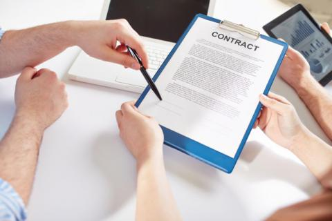 People reviewing contract